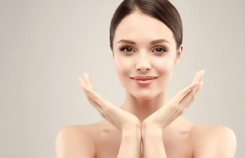 young woman with clean fresh skin holding her hands up-img-blog