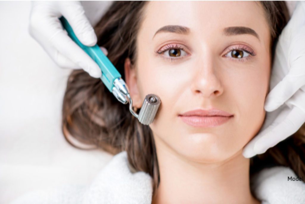 A woman receiving a microneedling treatment to boost collagen and elastin development, while minimizing scars and wrinkles.