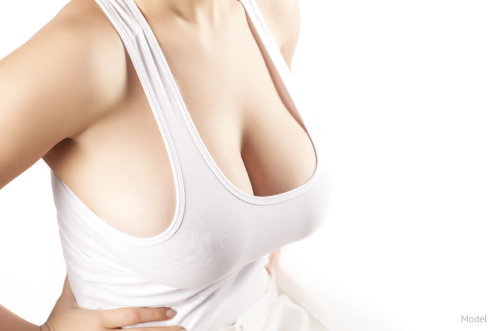 A woman after her breast augmentation surgery to enhance her breast size and correct inverted nipples.